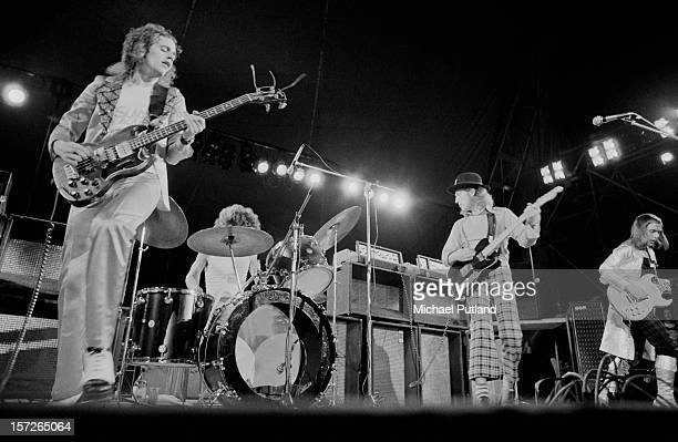 English rock group Slade performing at the Great Western Express Lincoln Festival Bardney Lincolnshire 28th May 1972 Left to right Jim Lea Don Powell...