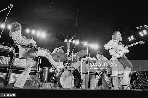 English rock group Slade performing at the Great Western Express Lincoln Festival, Bardney, Lincolnshire, 28th May 1972. Left to right: Jim Lea, Don...