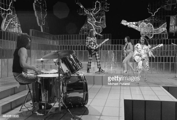 English rock group Slade performing on the Christmas Day edition of the BBC TV music show 'Top Of The Pops' broadcast 25th December 1973 Left to...