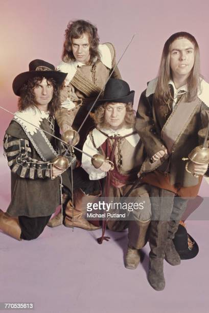 English rock group Slade posing in cavalier costumes and holding swords London 1974 The group are from left to right drummer Don Powell bassist Jim...