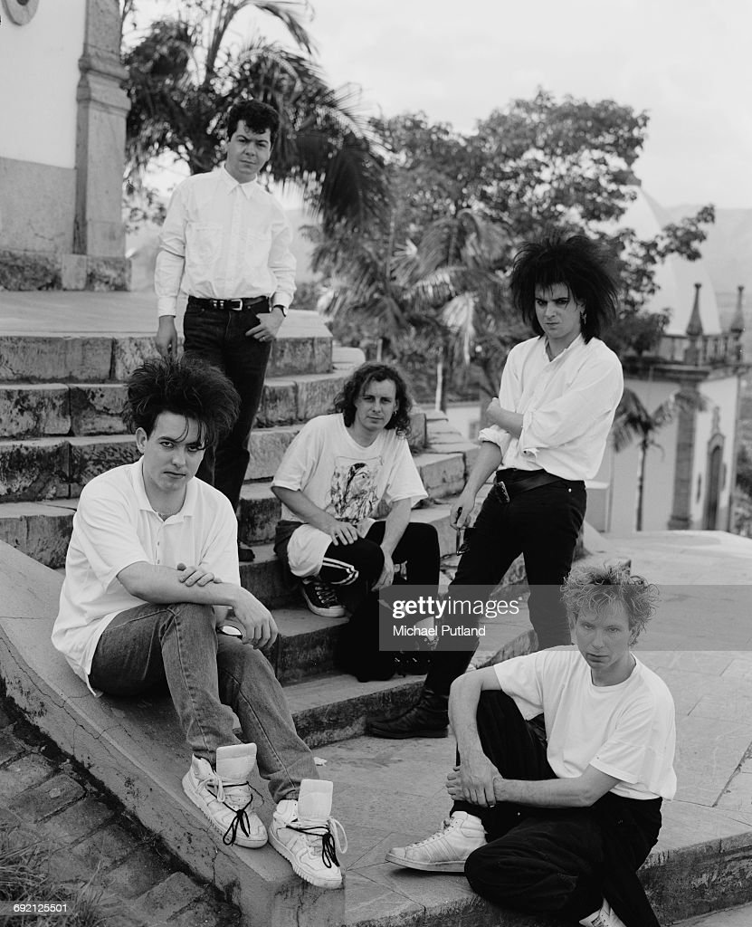English rock group The Cure in Brazil dufrontring their 1987 tour, 30th March 1987. Clockwise, from left: singer Robert Smith, keyboard player Laurence 'Lol' Tolhurst, guitarist Porl Thompson (centre), bassist Simon Gallup and drummer Boris Williams.