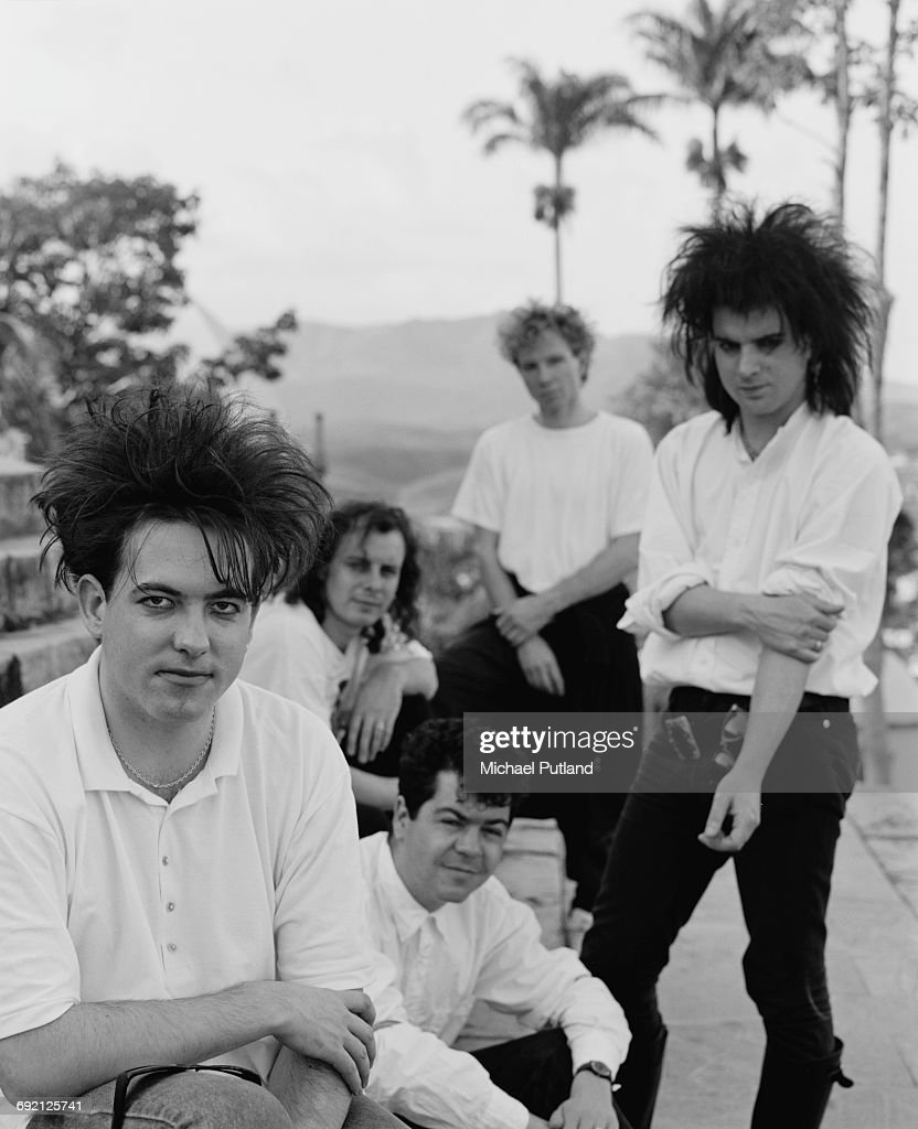 English rock group The Cure in Brazil during their 1987 tour, 30th March 1987. Left to right: singer Robert Smith, guitarist Porl Thompson, keyboard player Laurence 'Lol' Tolhurst, drummer Boris Williams and bassist Simon Gallup.