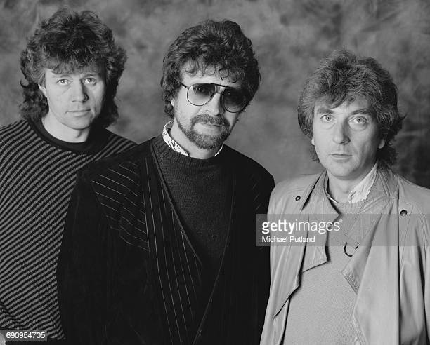 English rock group The Electric Light Orchestra February 1985 Left to right drummer Bev Bevan singer songwriter and musician Jeff Lynne and keyboard...
