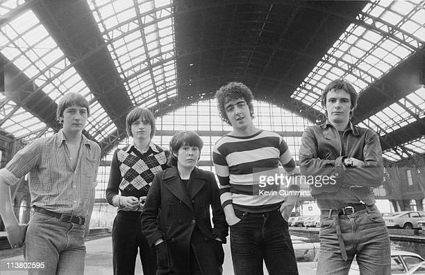 English rock group The Fall at Manchester Central railway station 1978 Left to right bassist Marc Riley singer and lyricist Mark E Smith keyboard...