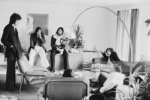 English rock group The Kinks at a record company office in London 11th April 1975 Left to right singer Ray Davies drummer Mick Avory bassist John...