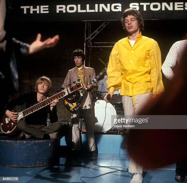 GO Photo of ROLLING STONES and Bill WYMAN and Brian JONES and Mick JAGGER LR Brian Jones Bill Wyman Mick Jagger performing Paint It Black at Wembley...
