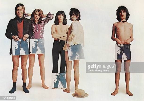 English rock group the Rolling Stones pose strategically holding copies of their new album 'Sticky Fingers' in a humorous group portrait to promote...