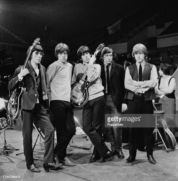 English rock group The Rolling Stones posed on stage during rehearsals before Ready Steady Go's live television broadcast of the Rave Mad Mod Ball at...