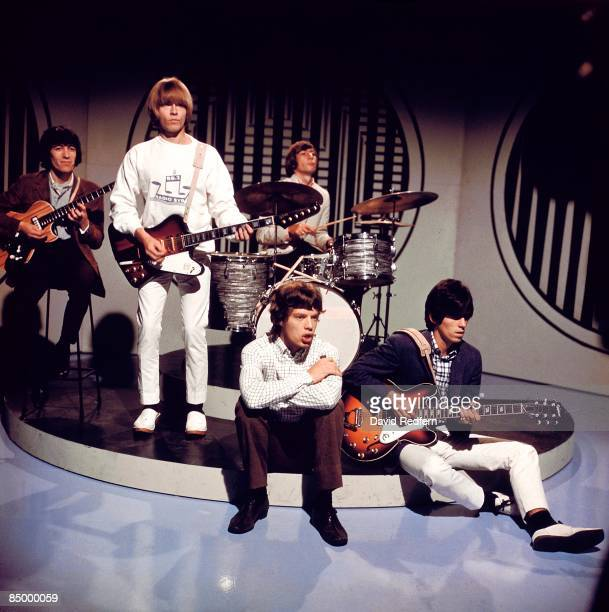 English rock group The Rolling Stones posed on the set of the ABC Television pop music television show Thank Your Lucky Stars at Alpha Television...