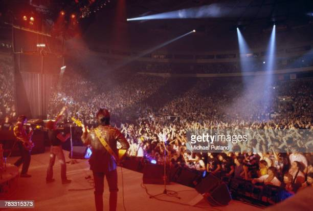 English rock group The Who perform live on stage during a concert date on the band's tour of the United States in September 1979 The group are from...