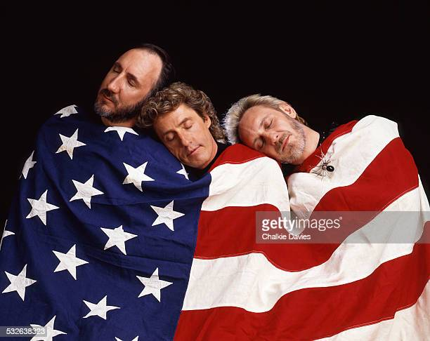 English rock group The Who wrapped in the stars and stripes New York 1989 Left to right guitarist Pete Townshend singer Roger Daltrey and bassist...