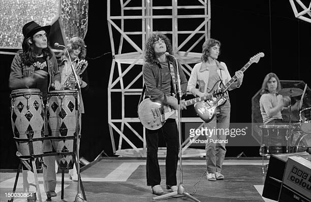 English rock group TRex performing on the BBC television show 'Top of the Pops' London 4th August 1971 Left to right Mickey Finn unknown Marc Bolan...