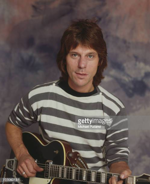 English rock guitarist and musician Jeff Beck posed with a guitar in London in October 1984
