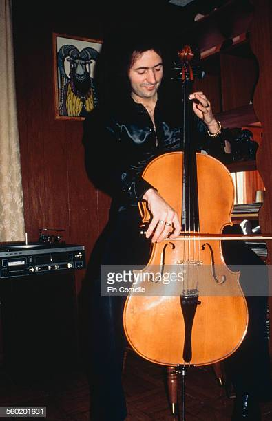 English rock guitarist and songwriter Ritchie Blackmore of Deep Purple playing a cello 1974
