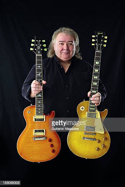 English rock guitarist Bernie Marsden famous for his work with English rock band Whitesnake holding his PRS SE Bernie Marsden Signature and 1959...