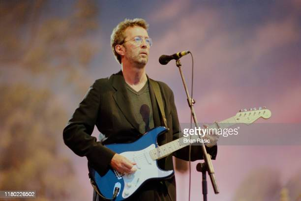 English rock guitarist Eric Clapton performs live on stage during the Pavarotti and Friends for War Child benefit concert at Parco Novi Sad in...