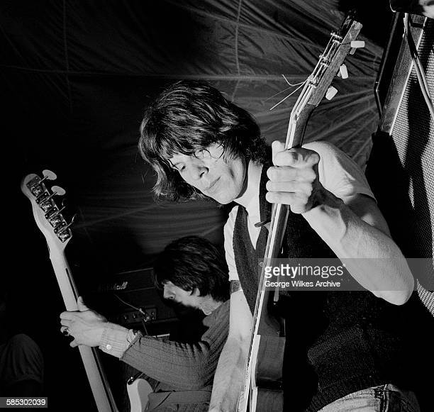 English rock guitarist Jeff Beck and Ron Wood on bass guitar performing on stage as the Jeff Beck Group