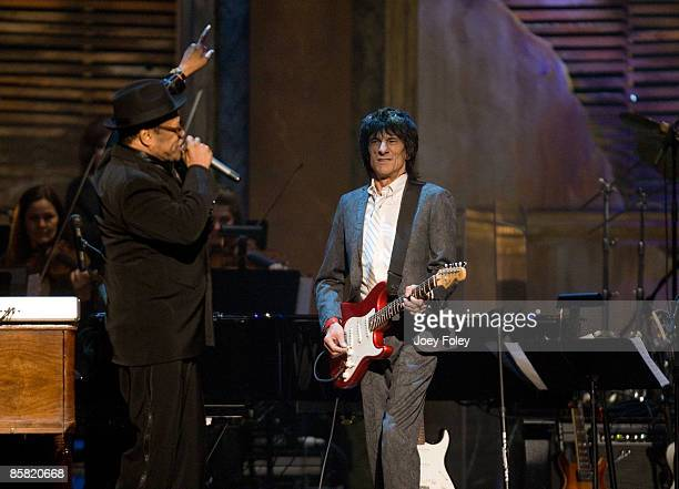English rock guitarist Ronnie Wood joins American singersongwriter Bobby Womack onstage together during the 24th Annual Rock and Roll Hall of Fame...