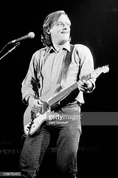 English Rock musician David Gilmour plays guitar as he performs onstage at the Capitol Theatre, Passaic, New Jersey, November 3, 1984. He played...