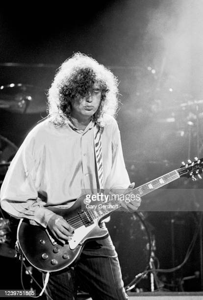English Rock musician Jimmy Page plays gutar as he performs onstage during his 'Outrider' tour at Nassau Coliseum, Uniondale, New York, October 28,...