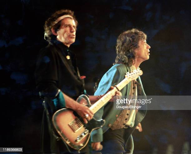 English Rock musician Keith Richards , on guitar, and vocalist Mick Jagger, both of the group the Rolling Stones, perform onstage during the group's...