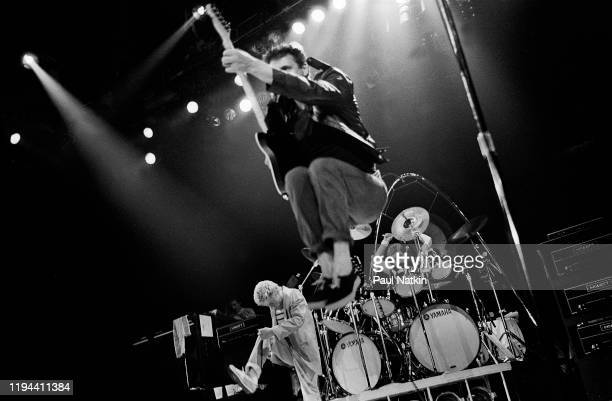 English Rock musician Pete Townshend of the group the Who jumps as he plays guitar during a performance onstage at the Rosemont Horizon Rosemont...