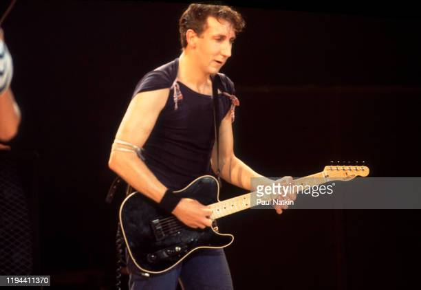 English Rock musician Pete Townshend of the group the Who plays guitar as he performs onstage at the Rosemont Horizon Rosemont Illinois October 5 1982