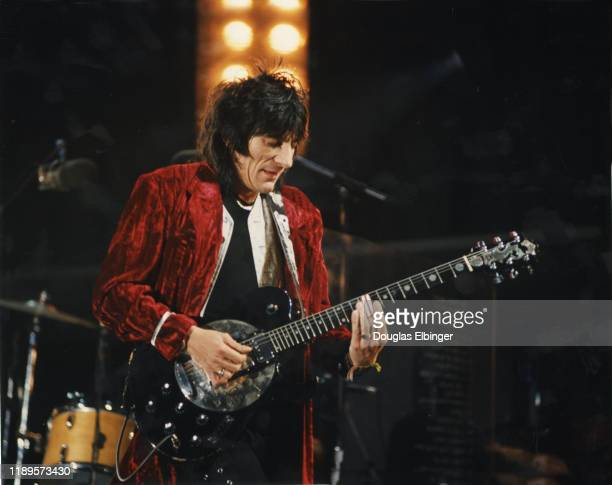 English Rock musician Ronnie Wood of the group the Rolling Stones plays guitar as he performs onstage during the group's 'Voodoo Lounge Tour' at...
