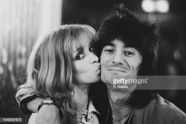 English rock musician, songwriter, multi-instrumentalist, artist, author Ronnie Wood of rock band The Rolling Stones with his partner Jo, UK, 26th...