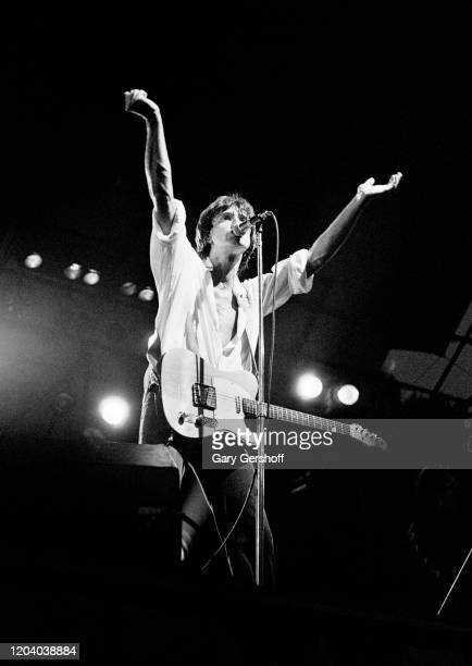 English Rock & Pop musician Ray Davies, of the group the Kinks, plays guitar as he performs onstage during the Dr Pepper Central Park Music Festival,...
