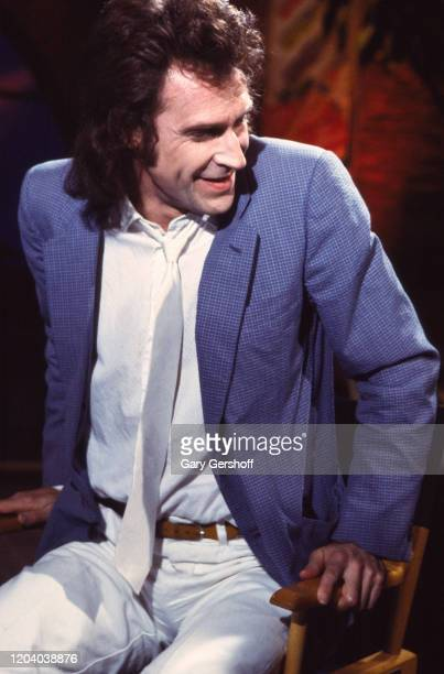 English Rock Pop musician Ray Davies of the group the Kinks sits in a director's chair during an interview at MTV Studios New York New York June 17...