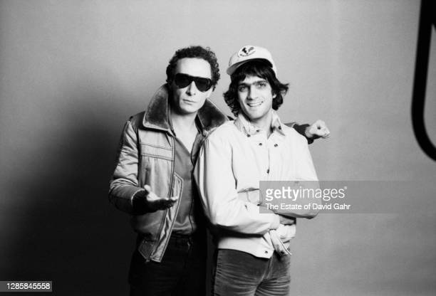 English rock singer songwriter, musician, and band leader Graham Parker and record executive and producer Jimmy Iovine pose for a portrait on April...