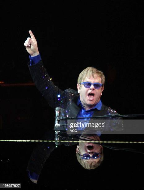 English rock singersongwriter composer pianist and occasional actor Elton John performs on stage during his concert at MasterCard Center on November...