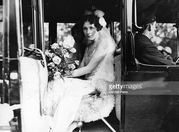 English romantic novelist Barbara Cartland in a car parked on The Mall, near Buckingham Palace, London, before her presentation at court, 1926....