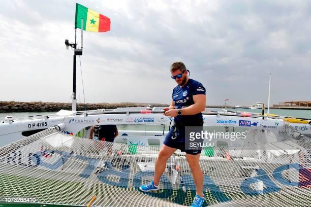 English rower of the Row4ocean rowing trimaran Andrew Ruinoff checks the last details before leaving Dakar to cross the Atlantic on December 14 2018...