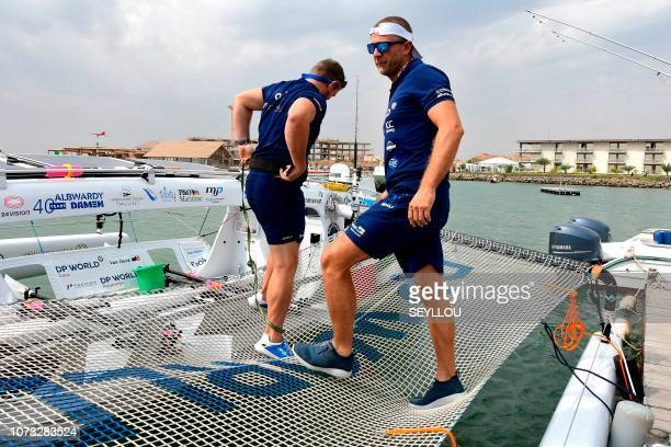 English rower of the Row4ocean rowing trimaran Matt Wilds and a teammate check the last details before leaving Dakar to cross the Atlantic on...
