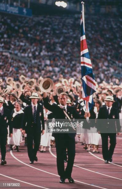 English rower Steve Redgrave carries the flag for the British team during the opening ceremony of the Barcelona Olympic Games 25th July 1992
