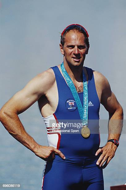English rower Steve Redgrave pictured wearing his fifth gold medal on the podium after the Great Britain team finished in first place to win the gold...