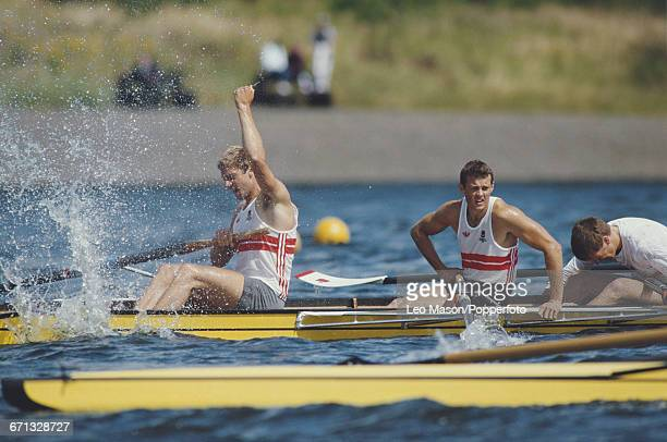 English rower Steve Redgrave raises one arm in the air in celebration after the England coxed fours boat finished in first place to win the gold...
