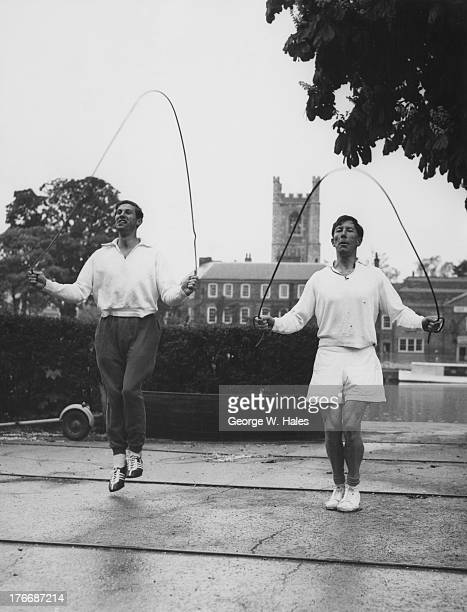 English rowers David Anthony Terence Leadley and Chris Davidge practice on the River Thames for the upcoming Empire Games HenleyOnThames Oxfordshire...