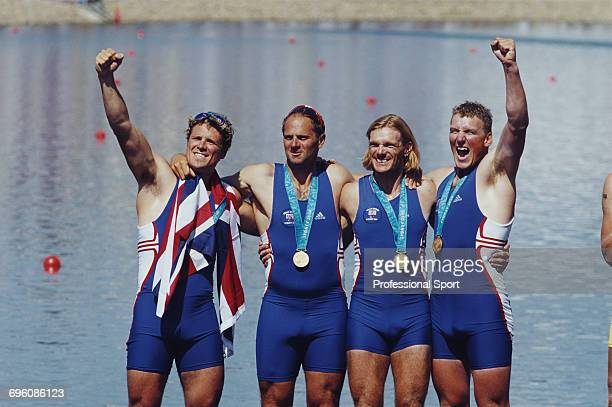 English rowers from left James Cracknell Steve Redgrave Tim Foster and Matthew Pinsent pictured together celebrating with their gold medals on the...