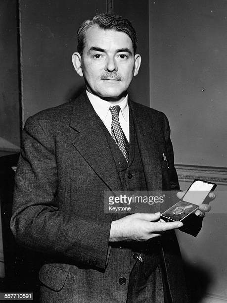 English Royal Air Force engineer Sir Frank Whittle inventor of the turbojet engine holding his investiture circa 1948