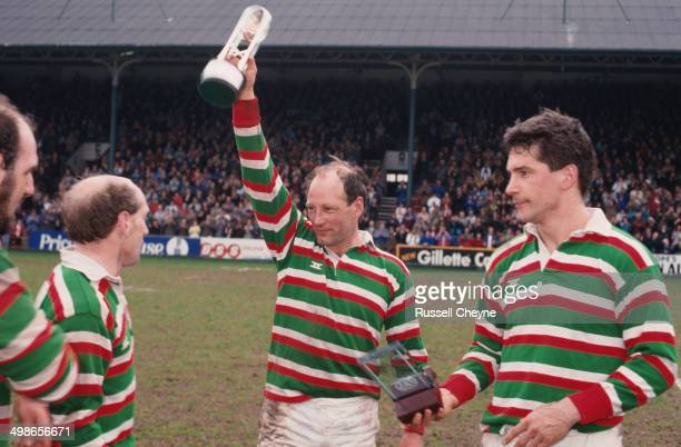 English rugby player Dusty Hare of Leicester Tigers lifts the trophy after his team's 3915 win against Waterloo RFC won them the Courage League...