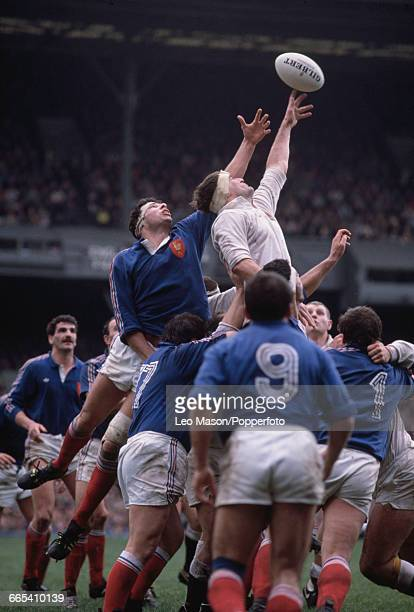 English rugby union lock forward Paul Ackford pictured in action leaping to win the ball for England in the 1989 Five Nations Championship match...
