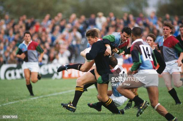 English rugby union player Damian Hopley of the London Wasps is tackled by Will Carling of the Harlequins circa 1995