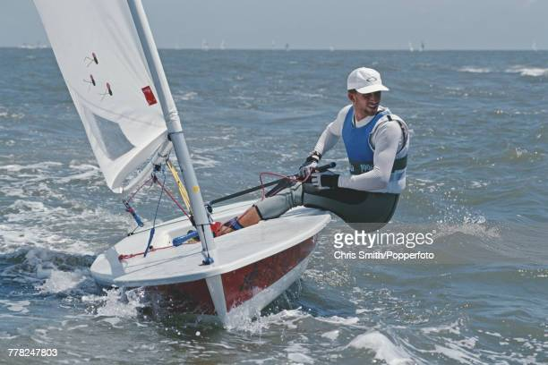 English sailor Ben Ainslie pictured in action during competition to finish in 2nd place to win the silver medal for Great Britain in the Laser class...
