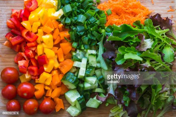 english salad on a board - pared stock pictures, royalty-free photos & images