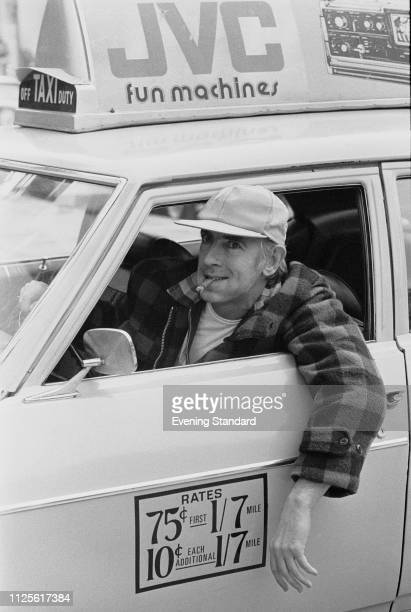 English satirist and comedic actor Peter Cook driving a taxi UK 23rd April 1980