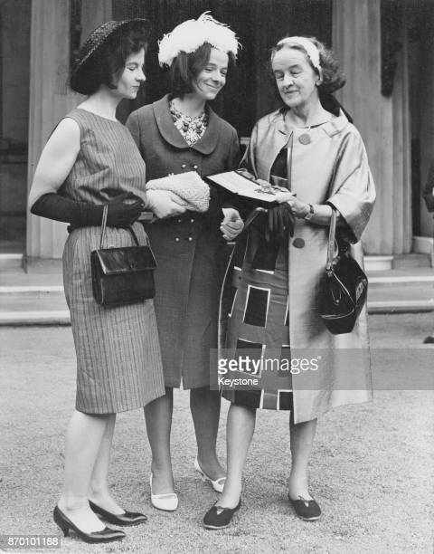 English sculptor Barbara Hepworth with her daughters Mrs Rachel Kidd and Mrs Sarah Bowness after her investiture as Dame Commander of the Order of...