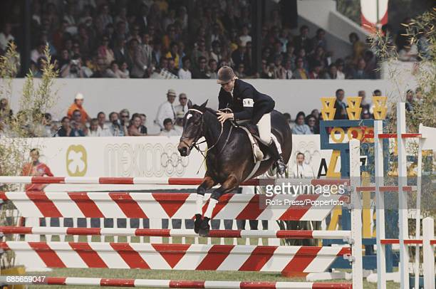 English show jumper Marion Coakes competes on her horse Stroller for Great Britain to finish in 2nd place to win the silver medal in the Individual...